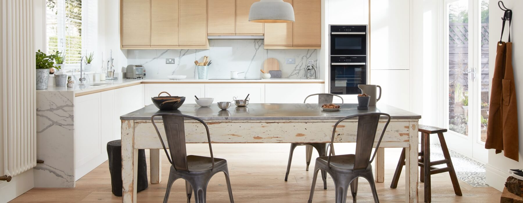 Alchemy Kitchens with table and chairs